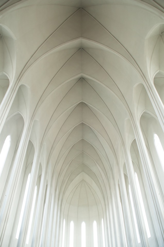 High white arches in a long building.